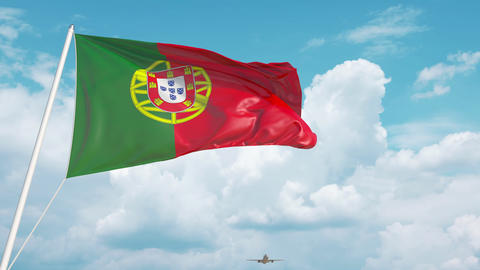 Commercial airplane landing behind the Portuguese flag. Tourism in Portugal Live Action