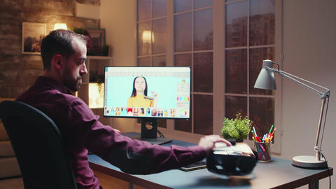 Freelancer photographer works on photos using modern retouching software Live Action