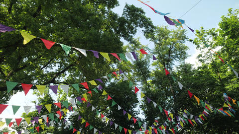 Festive garland of multi-colored paper flags for the holiday. Scenery for a Live Action