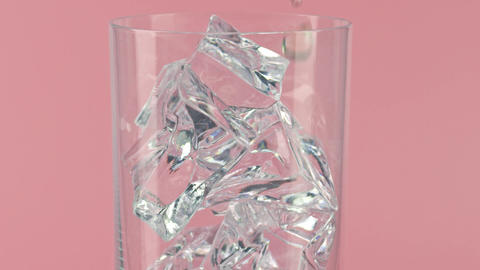 Pouring drink into a glass full of ice cubes against pink background, slow Live Action