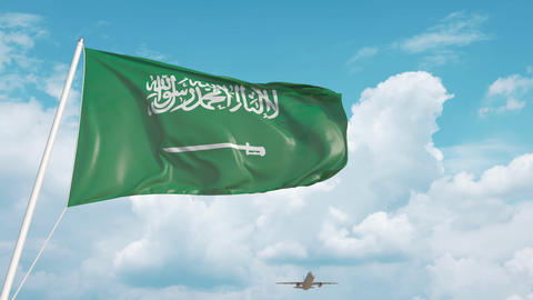 Commercial airplane landing behind the Saudi Arabia flag Live Action