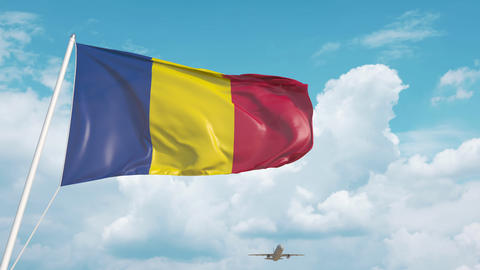 Commercial airplane landing behind the Romanian flag. Tourism in Romania Live Action