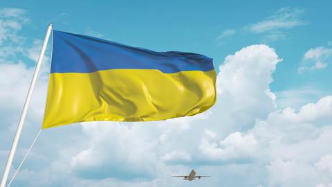 Plane arrives to airport with flag of Ukraine. Ukrainian tourism Live Action