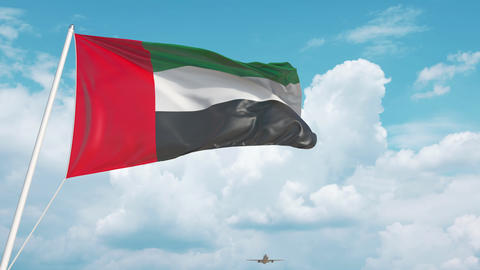 Airliner approaches the UAE flag. Tourism in the United Arab Emirates Live Action