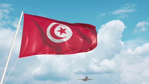 Airliner approaches the Tunisian flag. Tourism in Tunisia Live Action