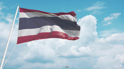 Airliner approaches the Thai flag. Tourism in Thailand Live Action