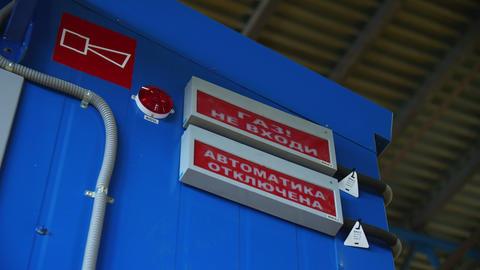 danger attention signs in gas compression station workshop Live Action