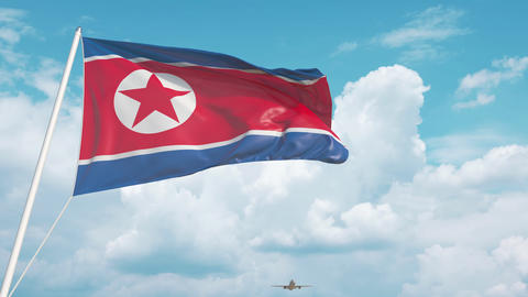 Commercial airplane landing behind the North Korean flag Live Action
