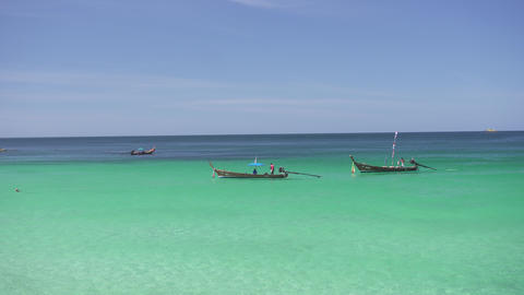 Fishing boats rest in calm waters Live Action
