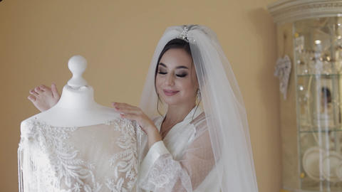 Beautiful and lovely bride in night gown and veil. Wedding dress. Slow motion ライブ動画