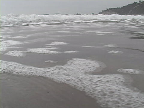 The tide rolls onto the shore Stock Video Footage