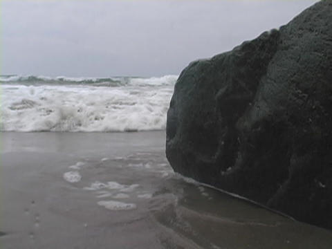 Waves roll towards the shore Stock Video Footage