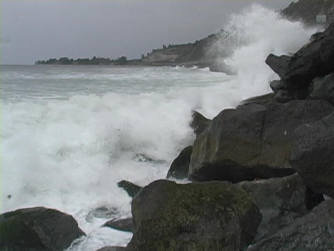 Ocean waves roll into the coastline Footage