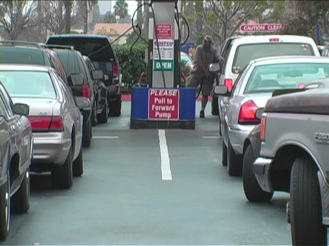 Long lines of cars wait for fuel at the gas pumps Stock Video Footage