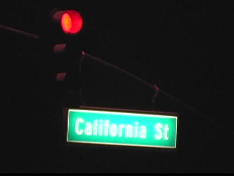 City street lights change at an intersection on... Stock Video Footage