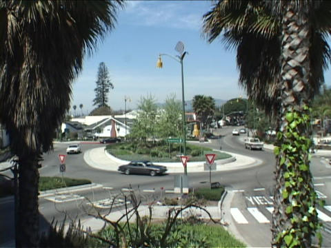 Traffic drives in a circle at an intersection Stock Video Footage
