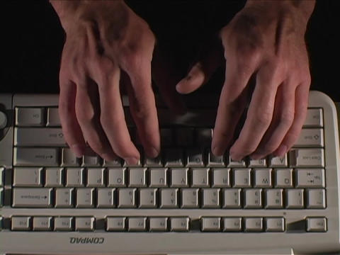 Fingers type quickly on a computer keyboard Footage