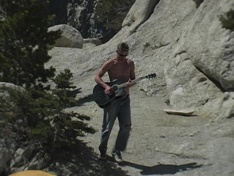 A man walks through wilderness Stock Video Footage