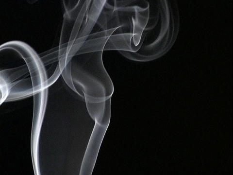 Smoke rises against a dark background Stock Video Footage