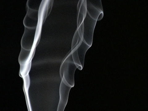 Smoke rises against a dark background Footage