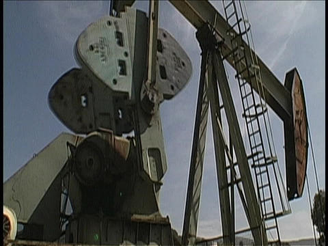 A derrick pumps oil Footage