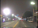 Traffic passes through the downtown area of a city Footage