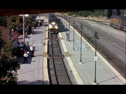 An Amtrak train pulls into a train station Footage