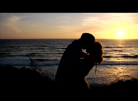 A couple embraces beside the sea Stock Video Footage