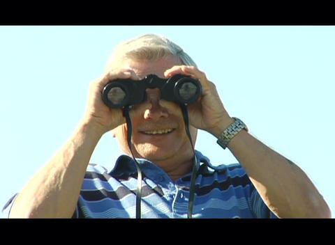 A man looks through binoculars Stock Video Footage