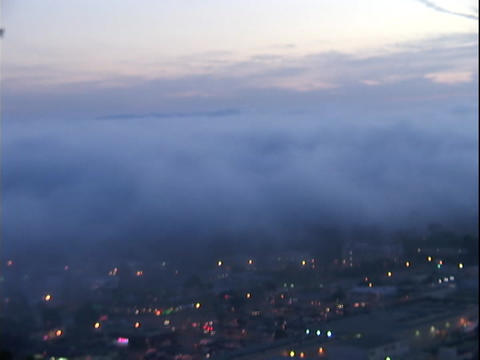 Fog drifts over a city Stock Video Footage