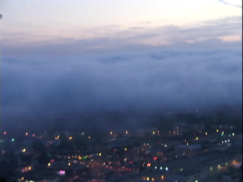Fog drifts over a city Footage