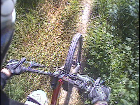 A mountain bike rides over a trail Footage