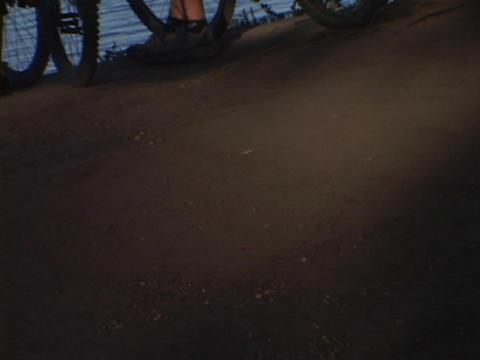 Mountain bikers overlook the ocean Stock Video Footage
