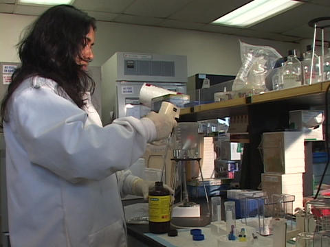 A medical researcher performs tests in a lab Footage