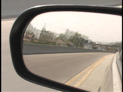 Traffic passes in a rear view mirror Stock Video Footage