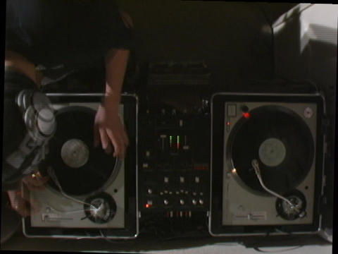 A disk jockey performs on turntables Stock Video Footage