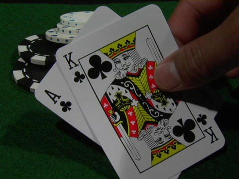 A gambler lays down an ace and a king Footage