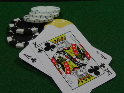 A gambler lays down an ace and a king Stock Video Footage