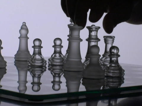 A chess player moves a queen Footage