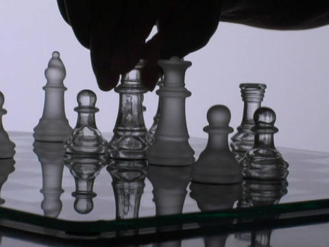 A chess player moves a queen Stock Video Footage