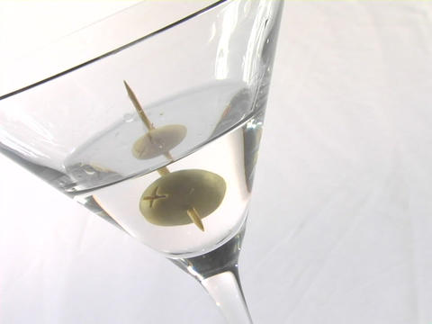 An olive sits in a martini glass Stock Video Footage