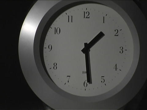 The hands on a clock spin quickly Stock Video Footage