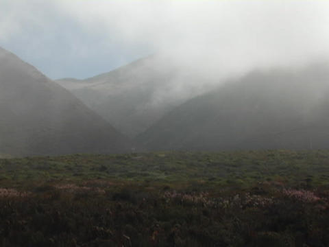 Time Lapse fog blows over the landscape of Scotland Stock Video Footage