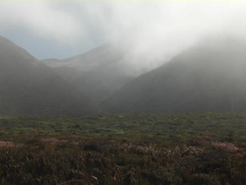 Time Lapse fog blows over the landscape of Scotland Footage