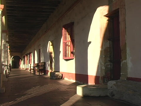 Light shines onto the portico and doorways of a Catholic... Stock Video Footage