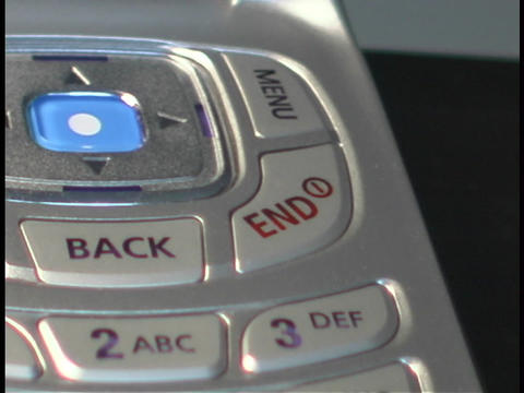 An open flip cell phone reveals a key pad Stock Video Footage