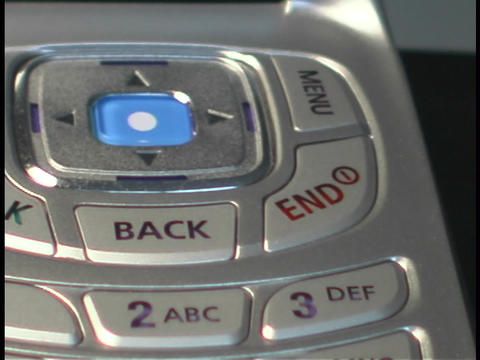 An open flip cell phone reveals a key pad Footage