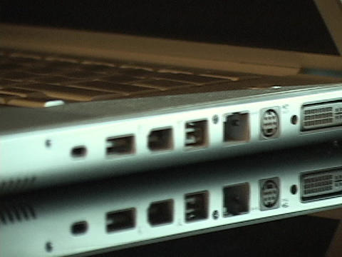 A firewire, USB port, and computer outlets line the edge... Stock Video Footage