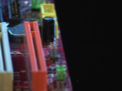 Chips and components lay in a motherboard Stock Video Footage