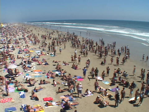 Crowds fill a Malibu beach Live Action